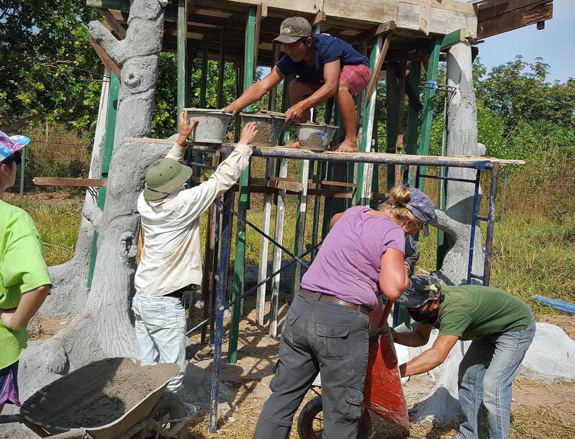 Volunteers construct new enclosures